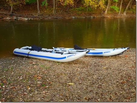 Kayaks on river bank