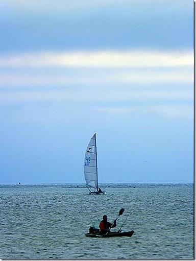 Kayak and sailboat