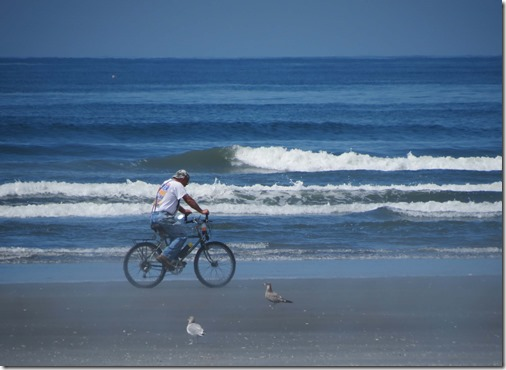 Bike rider on beach 2
