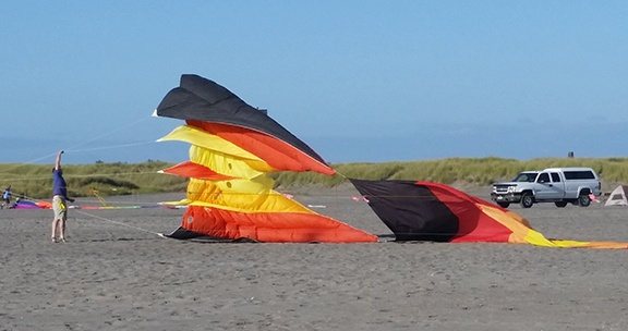 Inflating big kite small
